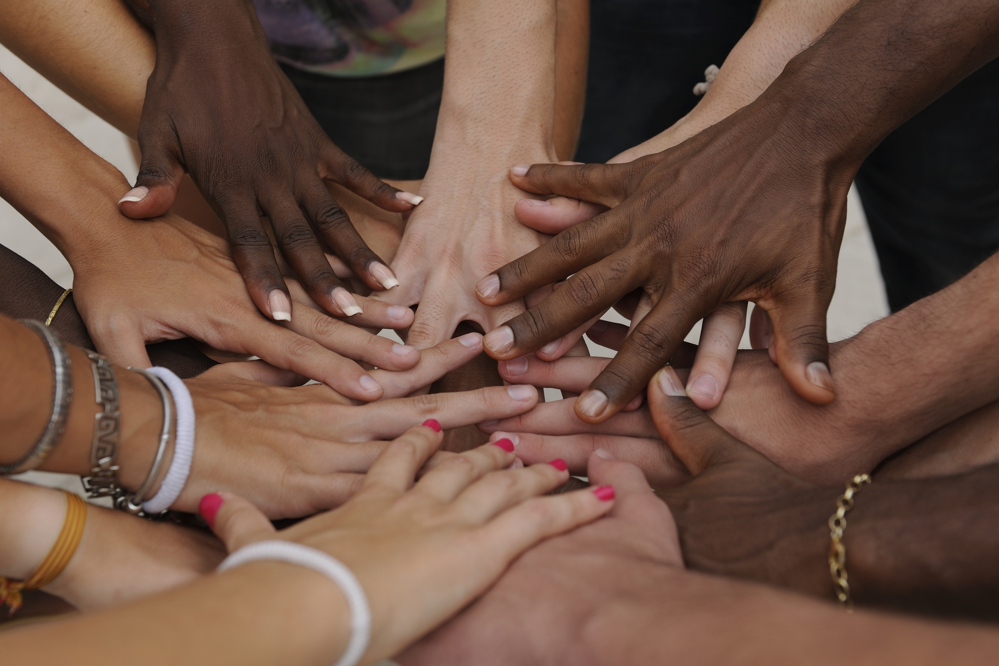 Many hands together group of joining hands