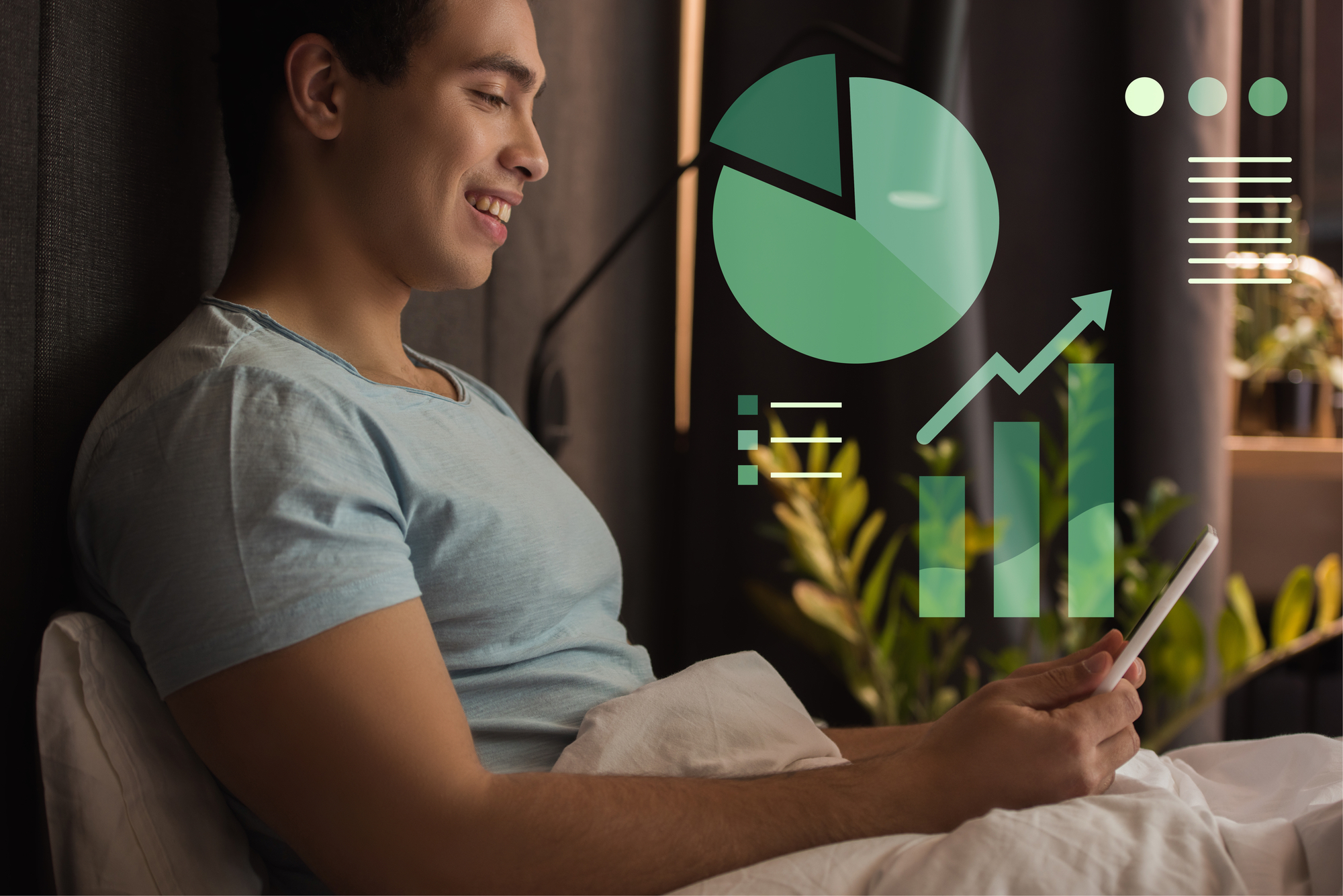 Smiling mixed race man using digital tablet in bed near charts and graphs illustration