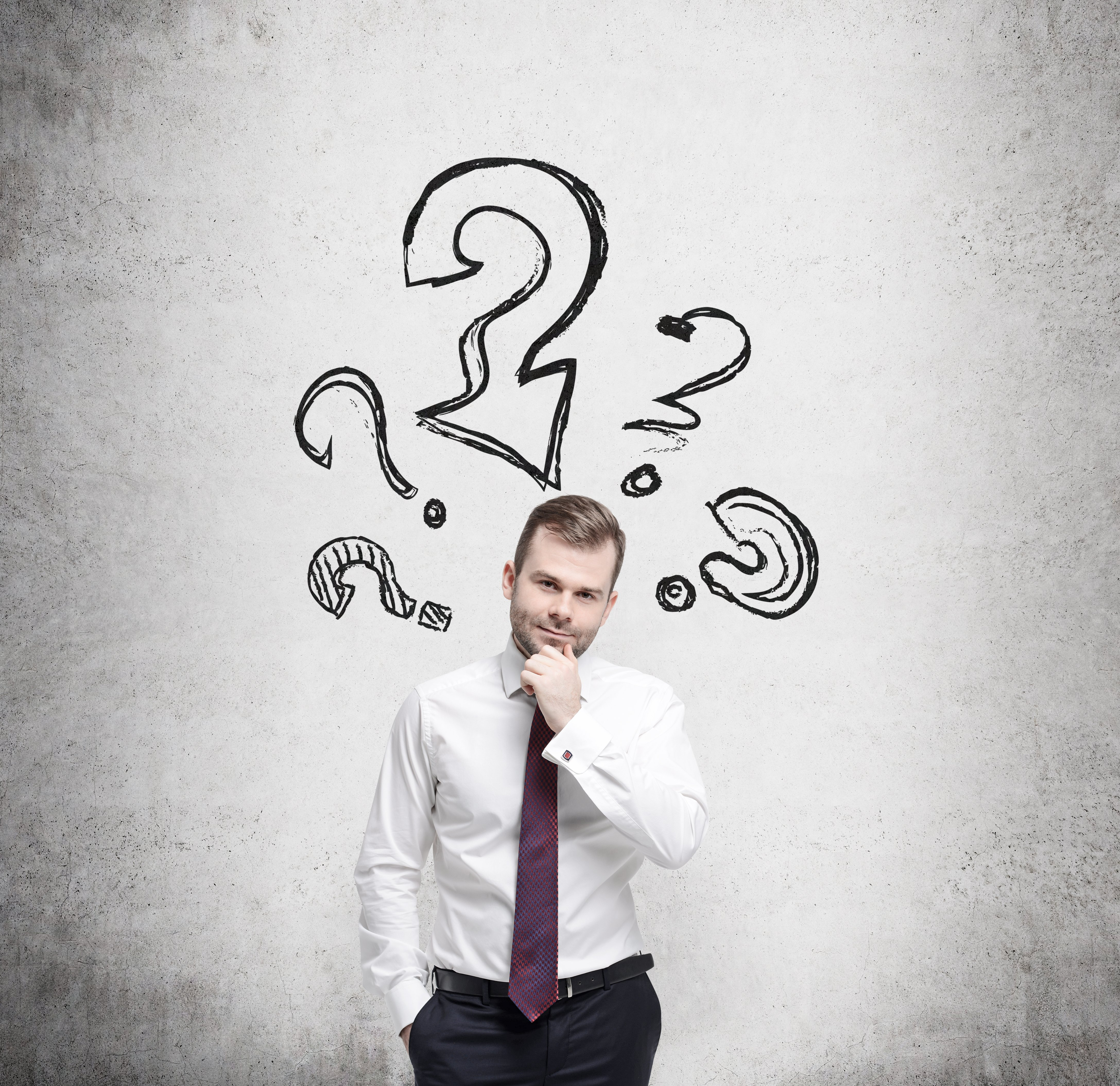 Young businessman is thinking about complicated questions